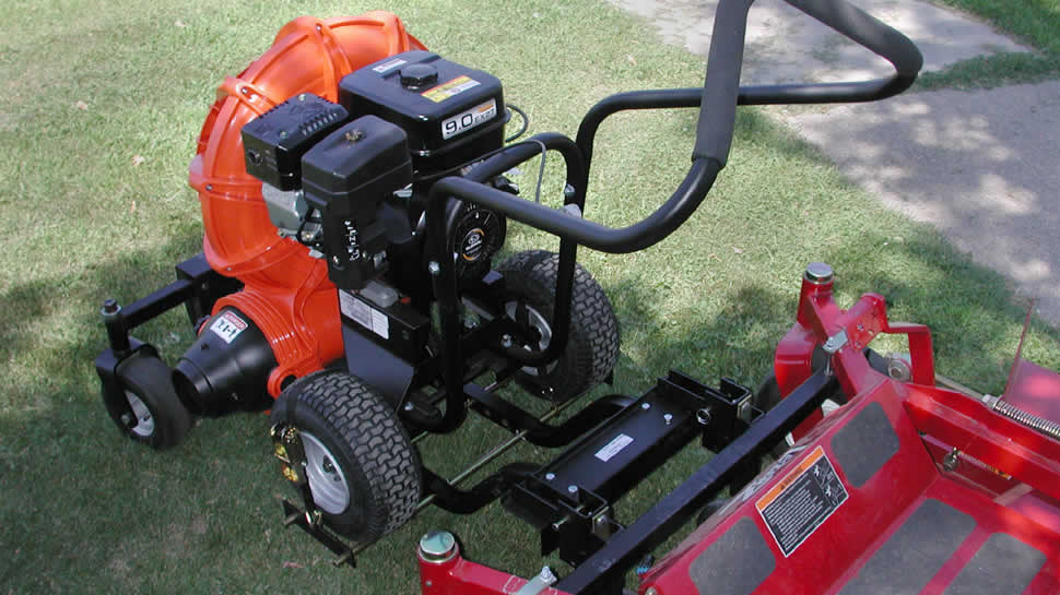 The blower attaches to the frame with ratchet straps.  The buggy adjusts to fit most walk-behind blowers.
