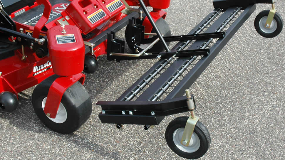 A lift handle raises and latches the rake for transport over pavement and curbs. A racheting release mechanism easily lowers the rake.