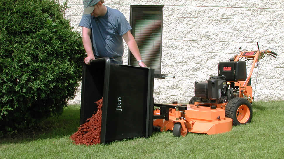 The pivoting dump mount makes the transporter ideal for unloading mulch and landscape materials.