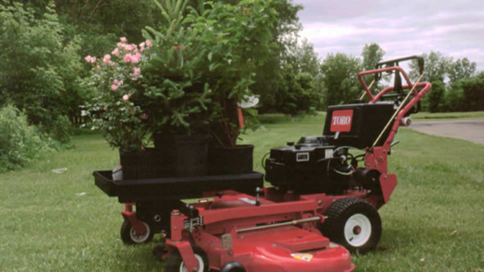 The JRCO Transporter tray can carry all kinds of landscaping plants and tools right up to the jobsite.