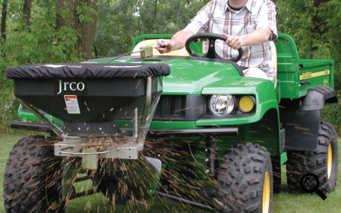 Action image of Jrco broadcast spreader mounted to utility vehicle